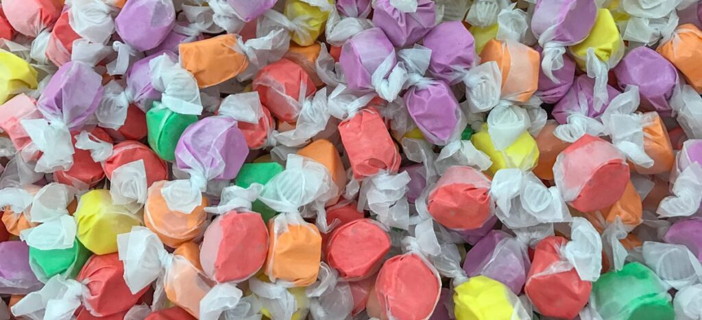 A pile of colorful saltwater taffy pieces