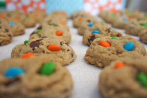 Cookies containing candy cooling, fresh from the oven.