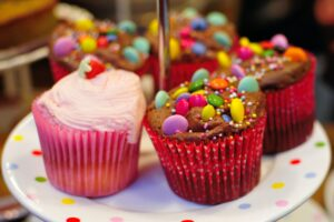 cupcakes topped with candy decorations